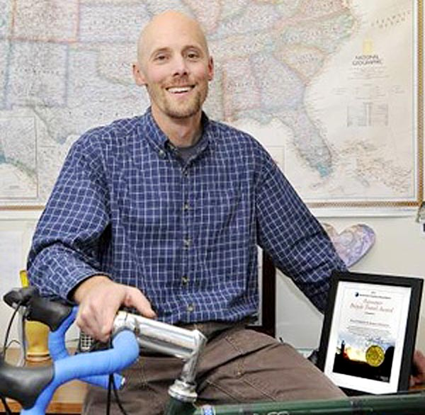 Apogee Adventures, founded by Kevin Cashman, above, won the 2011 Pacesetter Bicycle Travel Award from the Adventure Cycling Association because its youth trips emphasize hard work and community service.