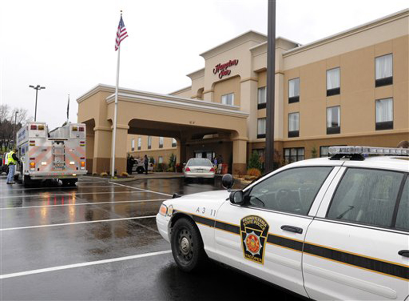 State Police in Indiana, Pa., arrest a suspect in connection with the White House shooting, at the Hampton Inn along Indian Springs Road in Indiana, Pa., Wednesday, Nov. 16. 2011. Oscar Ramiro Ortega-Hernandez, 21, was arrested without incident, according to police. (AP Photo/The Indian Gazette, Tom Peel)