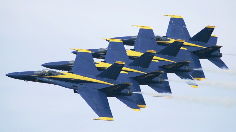 In this 2006 photo, the U.S. Navy Blue Angels precision flying team rehearses at Little Rock Air Force base in Jacksonville, Ark. The Navy's Blue Angels have been thrilling audiences for more than six decades with their acrobatic flying.