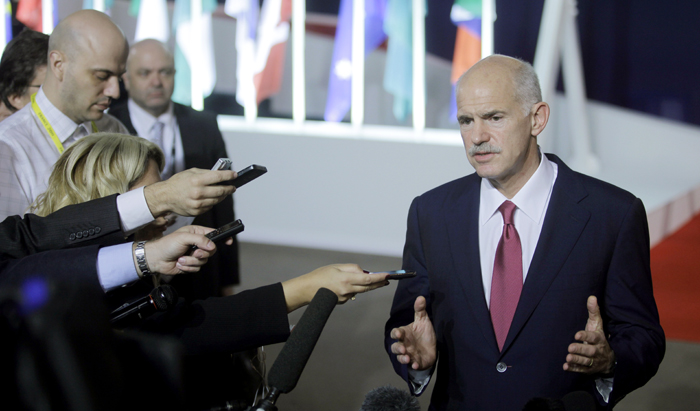 Greek Prime Minister George Papandreou speaks with the media as he leaves a G20 summit in Cannes, France, on Wednesday.
