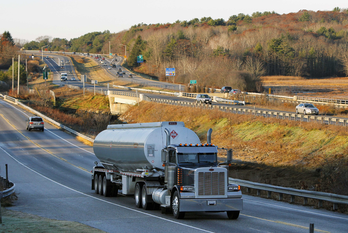 A heavy truck travels north on Route 1, alongside Interstate 295, in Yarmouth recently. Congress' vote to increase truck weight limits on federal highways in Maine and Vermont highlights the arguments for and against allowing heavier trucks on the nation's interstates.