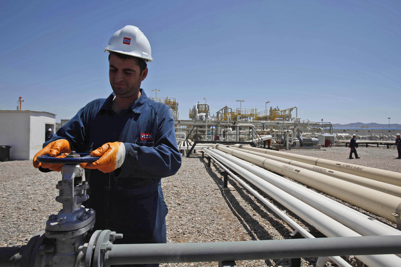 An employee works at the Tawke oil fields in the semiautonomous Kurdish region in northern Iraq on May 31, 2009. A Kurdish official says the Kurdish government has signed a deal with ExxonMobil to explore oil fields in northern Iraq.