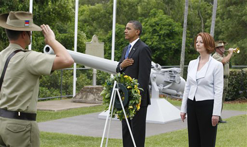 U.S. President Barack Obama and Australian Prime Minister Julia Gillard lay a wreath at the USS Peary Memorial in Darwin, Australia, Thursday, Nov. 17, 2011. (AP Photo/Charles Dharapak)