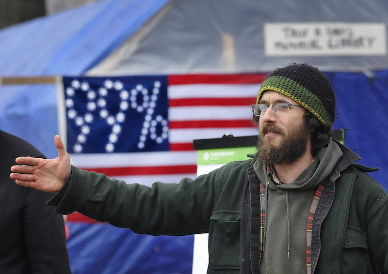 Staff Photo by Shawn Patrick Ouellette Jonah Fertig of Portland talks to a crowd at the Occupy Maine camp in Lincoln Park on Saturday, Nov. 26, 2011.