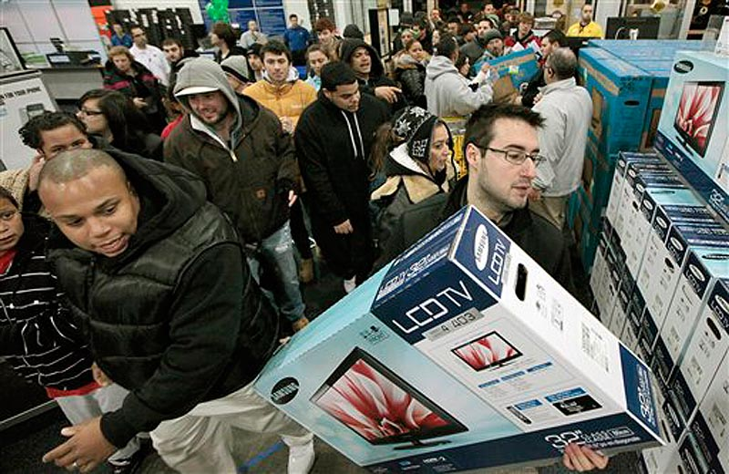 BlackÜFriday shoppers rush into Best Buy in North Dartmouth, Mass., early Friday, Nov. 25, 2011. Thousands of shoppers lined up at Macy's, Best Buy and other stores nationwide to buy everything from toys to tablets on Black Friday despite the economic downturn and some planned protests of the shopping holiday. (AP Photo/The Standard-Times, Peter Pereira) shop shopping buy economy black friday line wait money budget el