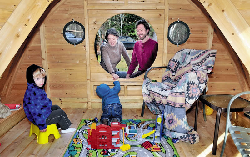 FUN STUFF: Melissa and Rocy Pillsbury watch from a round doorway as their children Richard, left, and Maximus play in one of the Hobbit Hole playhouses they make for their Wooden Wonders business in Unity. The buildings are designed from the J.R.R. Tolkein novels.