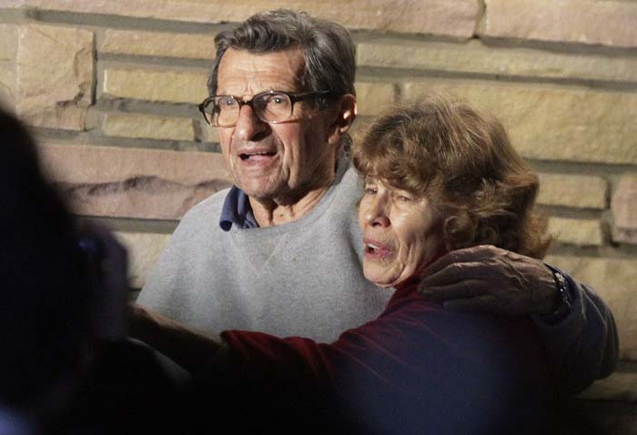 Joe Paterno and his wife Susan stand on their porch to thank well-wishers gathered outside in State College, Pa., on Wednesday.