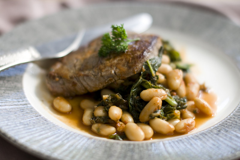 Filet of beef a la romana pairs lean tenderloin with healthy kale and cannellini beans in a flavorful combination.