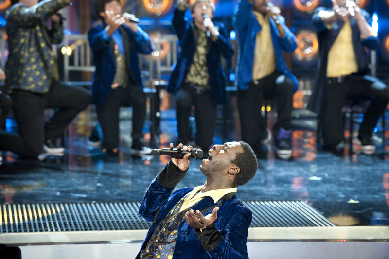 "Portland's Michael Odokara-Okigbo performs Monday night with the Dartmouth Aires on NBC's ""The Sing-Off."" They advanced to the next round of the competition."