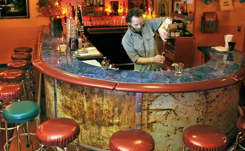 Dan Trefethen, the bar manager at El Camino, mixes a Dusty Cowboy (a tamarind margarita) at the funky Mexican watering hole in Brunswick.