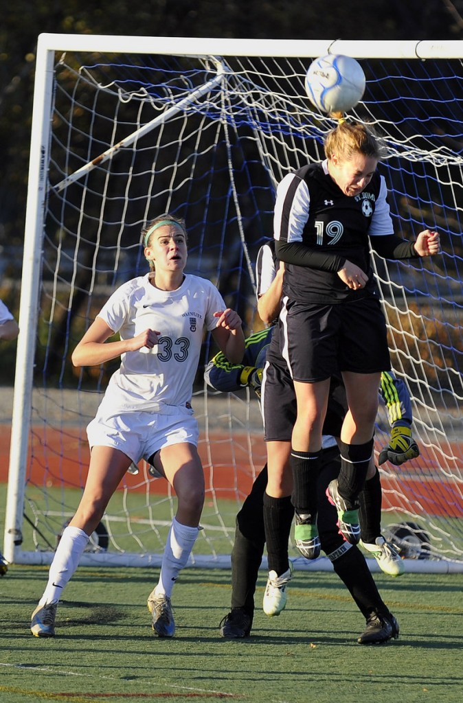 Dayle Jordan, who eventually scored the winning goal for St. Dominic, clears away a pass intended for Sadie Cole of Waynflete in the second half.