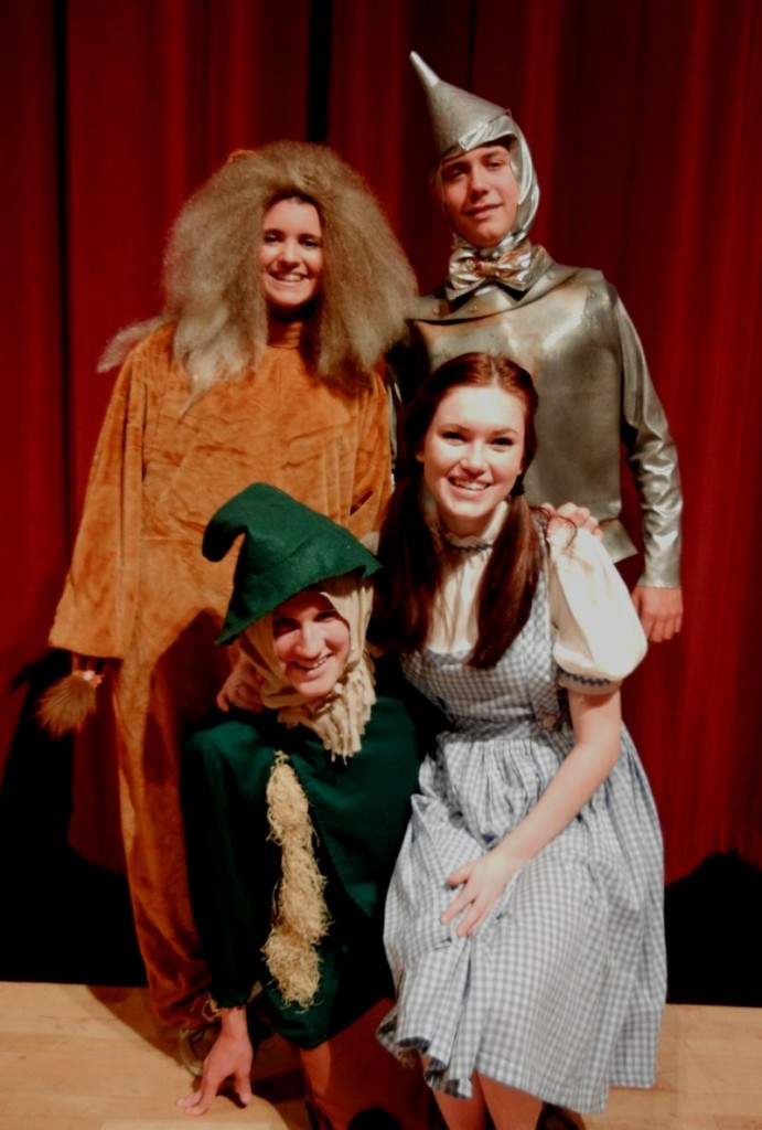 "The Cowardly Lion, Tin Man, Scarecrow and Dorothy Gale (Whitney Bolduc, Jamie McBride, Brad Meader and Georgia Noonan, respectively) pause for a picture while rehearsing Windham High School's ""The Wizard of Oz."""