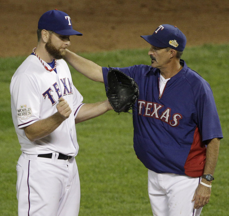 Texas Rangers hitting coach Mike Maddux, right, will be interviewed by both the Red Sox and Cubs as they look to fill their managerial openings.