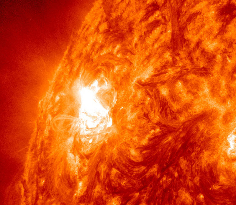 """This image provided by NASA shows giant sun spot activity Thursday from a region on the sun that scientists are calling a """"benevolent monster."""" After years of quiet, the sun is coming alive with solar storms in a big way."""