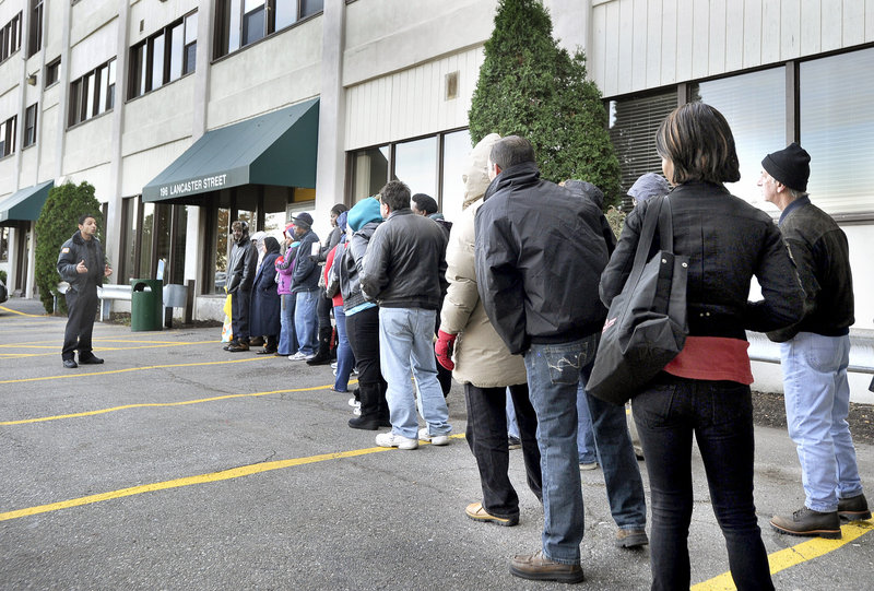 Nawaf Alsukaini, a security guard, directs people seeking help into the General Assistance office on Lancaster Street in Portland on Friday. The number of able-bodied men and women looking for a hand up to pay for rent, heat or other necessities has nearly tripled in the past four years.