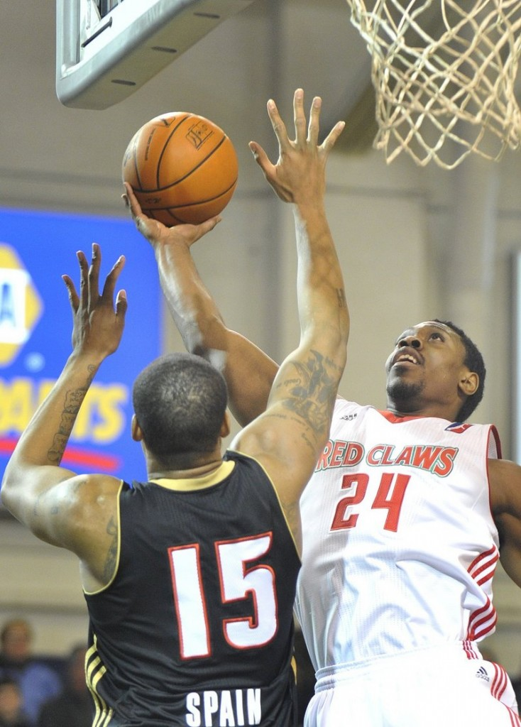 Paul Harris, right, will be returning to the Maine Red Claws after buying out his contract midway through last season and starring for a team in the Philippines.