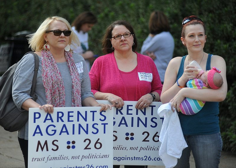 Parents against the MS 26 initiative attend a rally at the state Capitol in Jackson, Miss., on Thursday. Mississippi doctors gathered at the Capitol to express their opposition, supported by the Mississippi Nurses Association.