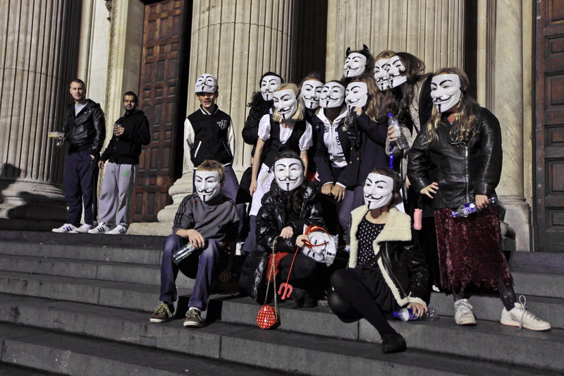 A group of London friends sport Guy Fawkes masks outside the Occupy London Stock Exchange protest camp near St. Paul's Cathedral on Thursday.