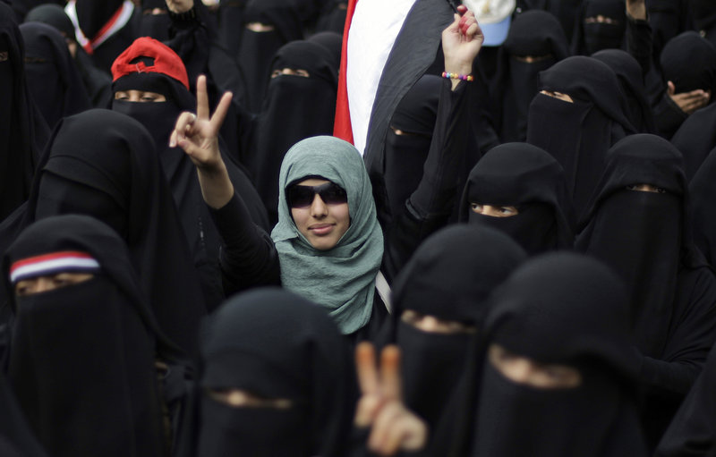 A female protester flashes the victory sign during a Sept. 6 demonstration in San'a, Yemen, demanding the resignation of President Ali Abdullah Saleh. Islamic elements are cracking down on women who have joined the revolt.