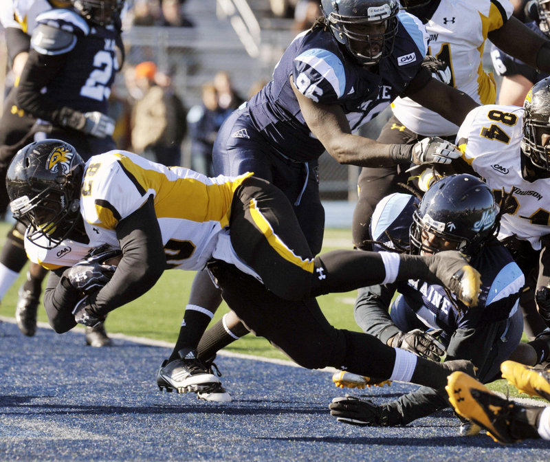 Terrance West of Towson scores in the first half against UMaine on Saturday at Orono. West ran for 184 yards in Towson's 40-30 win.