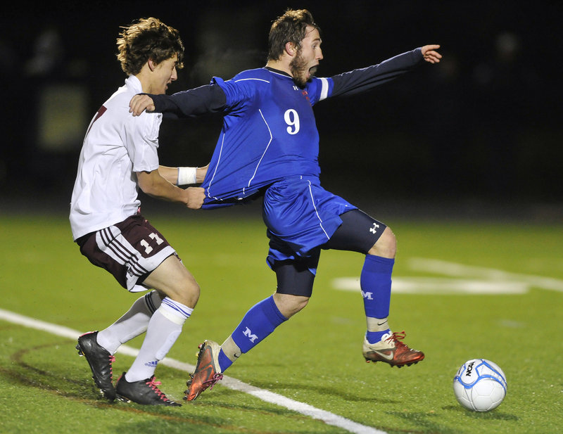Erik Gumaer of Windham wasn't about to let Christopher Hall of Messalonskee break away Saturday night – by any means possible. Gumaer received a yellow card but helped Windham earn the Gold Ball with a 3-1 victory.