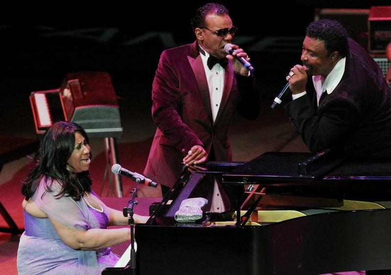 Aretha Franklin sings with Ronald Isley, center, and Dennis Edwards at the end of the Rock Hall's American Music Masters concert honoring her on Saturday in Cleveland.