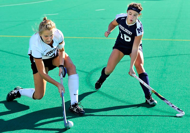 Ella Curren of Bowdoin takes a shot while being defended by Middlebury's Hannah Clarke Sunday in the NESCAC title game.