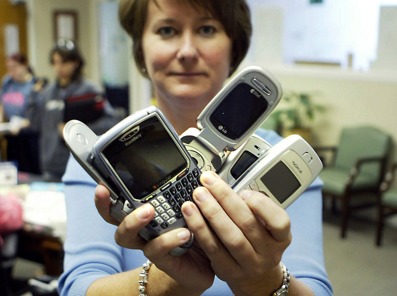An official holds confiscated cellphones at Arlington (Texas) High School in a 2007 file photo. Because of text-message bullying, the school confiscates any cellphones that students are caught with at school and requires students to pay a fine to get them back. A national survey being released today notes that sexual harassment and bullying can sometimes overlap.