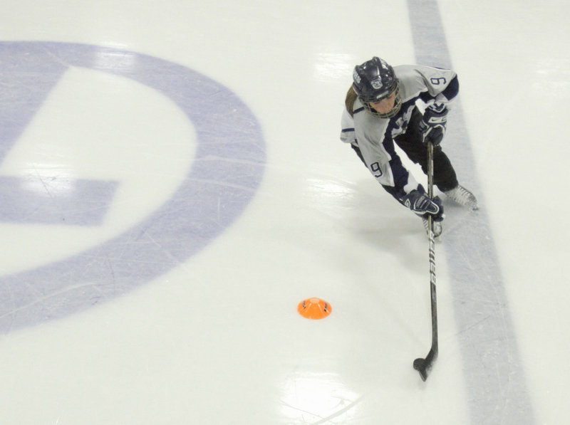 Drew Berry skates through a drill during Monday's opening practice. The first official games of the girls' hockey season are scheduled for Nov. 25, and Portland starts its season at Biddeford on Nov. 26.