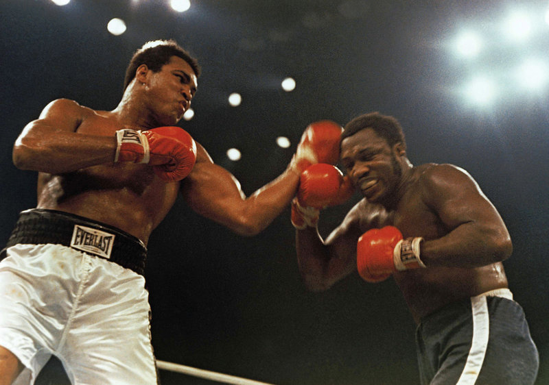 Joe Frazier, right, slugs it out with Muhammad Ali during a fight at Madison Square Garden – the second of their three fights. Frazier won the first, then lost the next two.