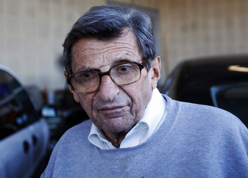 Head coach Joe Paterno leaves the football building on the Penn State campus Tuesday. University officials canceled his weekly news conference.
