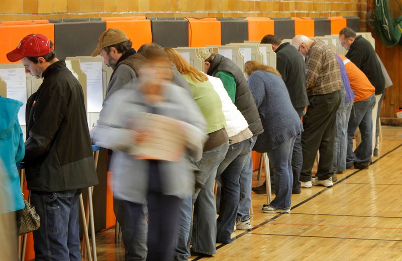 Voters cast ballots at Biddeford's Richard J. Martin Community Center Tuesday. Wards reported better than 50 percent turnout.