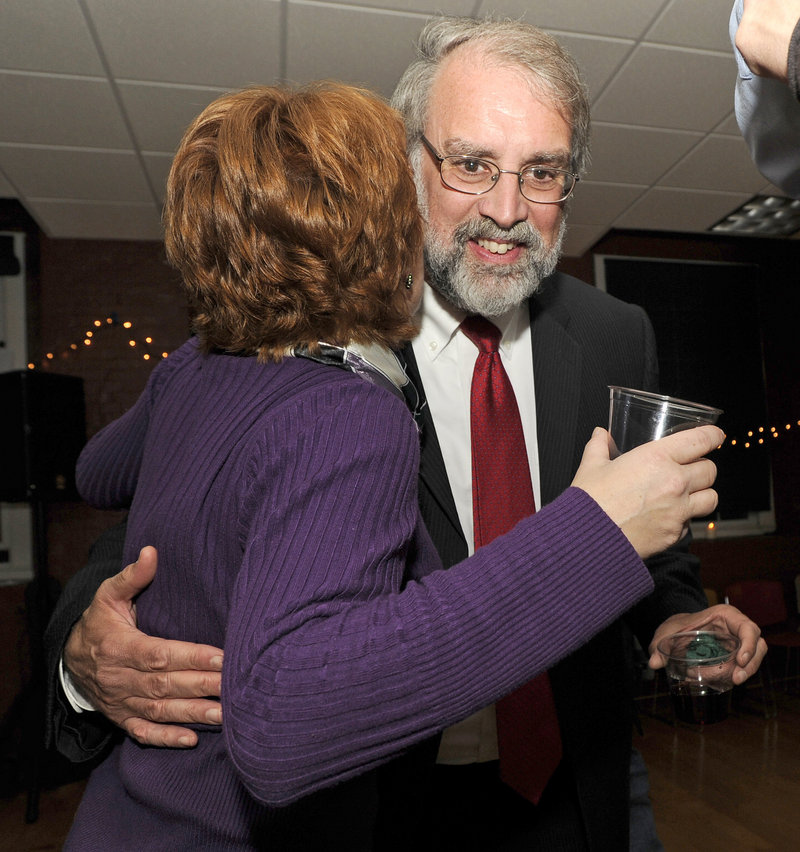 "Victorious mayoral candidate Alan Casavant gets a hug at his election night reception at the North Dam Mill. He told supporters: ""We need to accentuate Biddeford's attributes as a great place to live and work and go to school."""