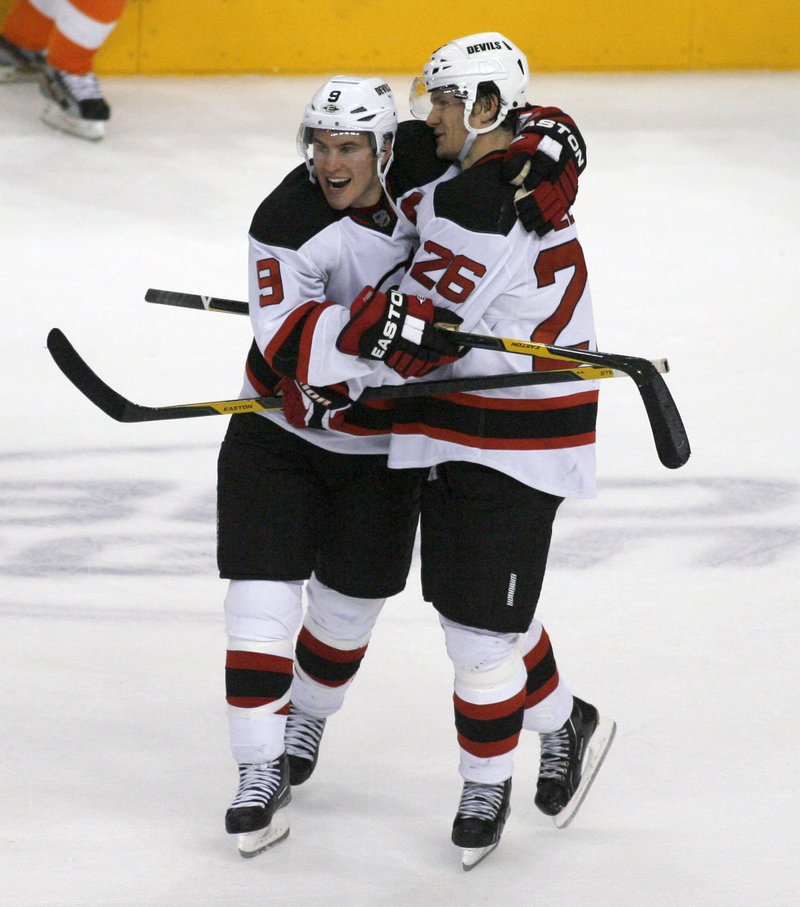 Zach Parise, left, is another American excelling in the NHL. He is one of the top goal scorers for the New Jersey Devils.