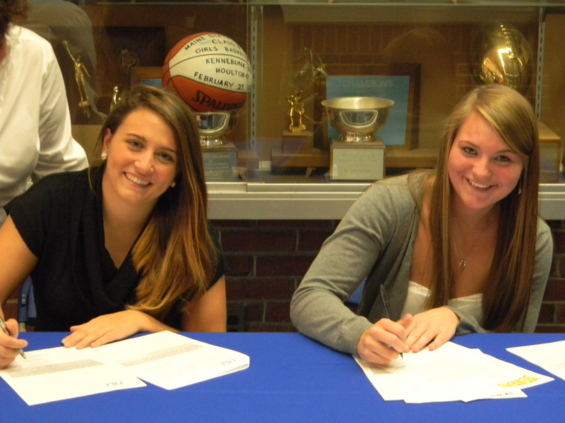 Maria Varano, left, will head to Siena to play tennis, and Janelle Bouchard, a softball catcher, plans to head to Valparaiso. Both play for Kennebunk High now, but signed letters of intent Wednesday for next season.