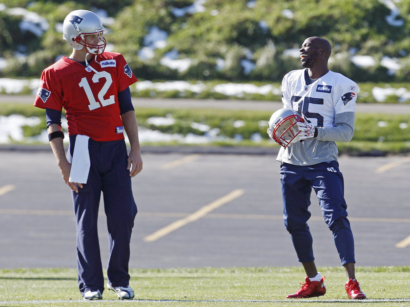 Tom Brady, left, and Chad Ochocinco still have to learn to connect as well on the field as they have during practice time with the Patriots.