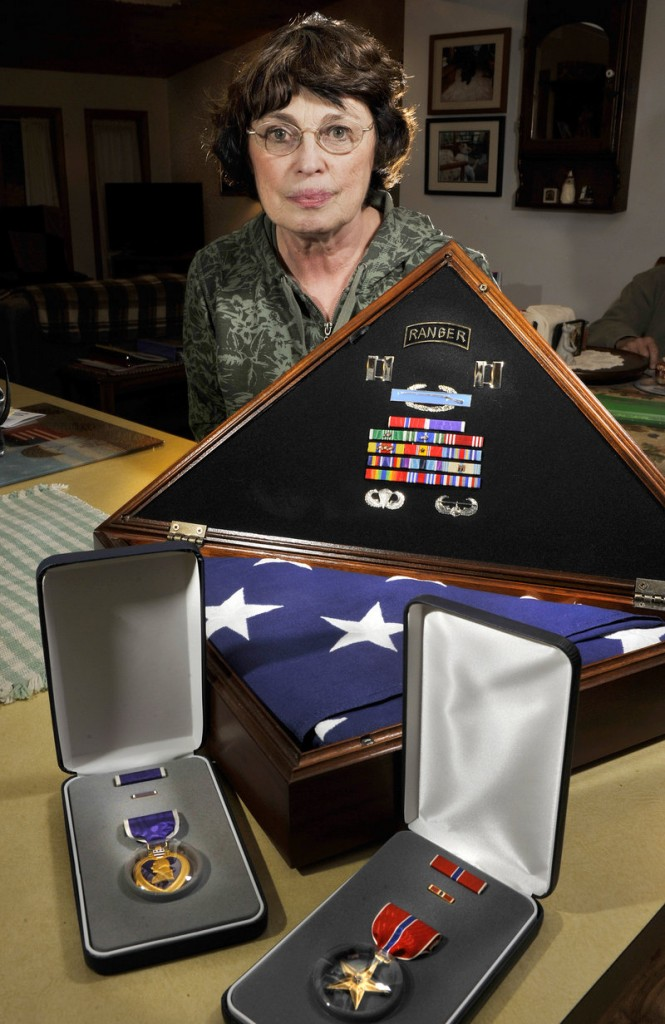 Nancy Lee Kelley, who will serve as grand marshal in today s Veterans Day Parade in Portland, lost her son, Army Capt. Christopher Cash, when he was killed by insurgents in Iraq in 2006. The Old Orchard Beach Gold Star Mother displays her son s medals and the flag that draped his coffin at his funeral.