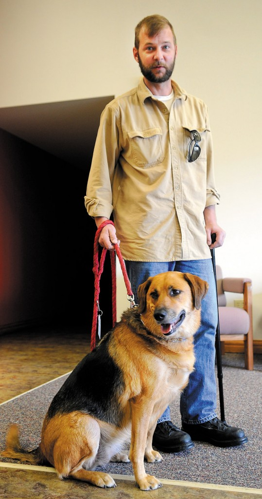 Former Army Sgt. Aaron Rollins and his service dog, Mabel, are shown recently in Augusta.