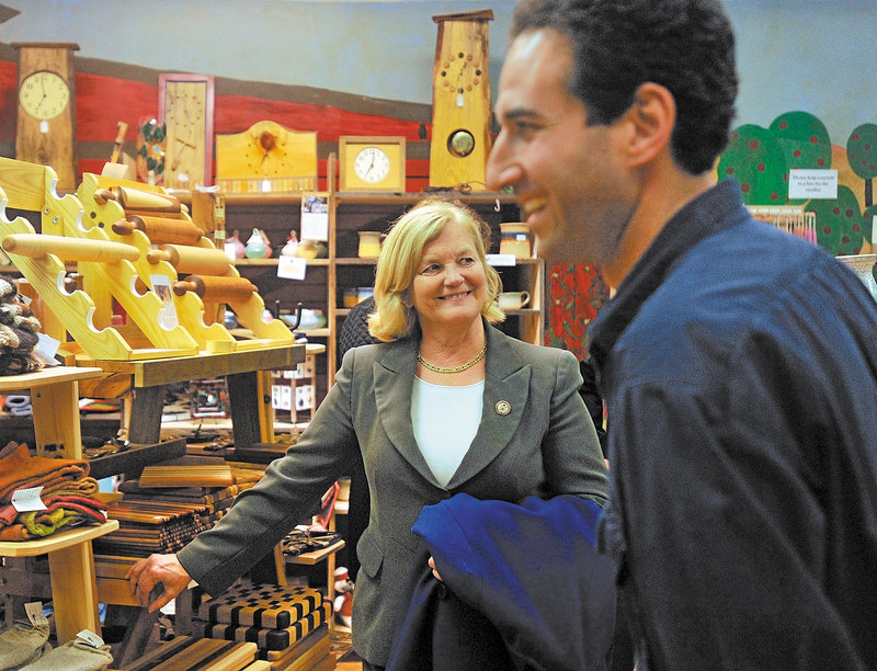 U.S. Rep. Chellie Pingree, center, talks with David Gulak, a store manager in Waterville, during a visit to the city Thursday. If Pingree wins re-election, Waterville will be in the 1st District because of redistricting.