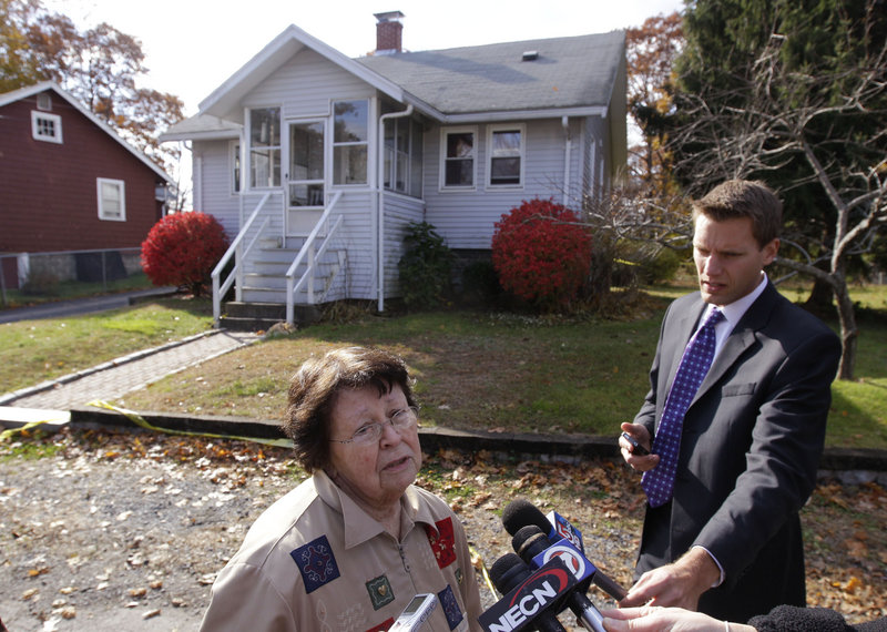 "Pat Connor, a neighbor, talks to reporters in front the house in Weymouth, Mass., where police say three people were killed Friday. Donald Rudolph, 18, has been charged in the killings of his mother, older sister and his mother's boyfriend after police found a ""gruesome scene"" at the home."