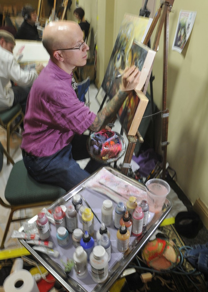 Chris Dingwell, a Portland tattoo artist, paints in front of an audience along with other local artists at the comics and fantasy entertainment convention Sunday.