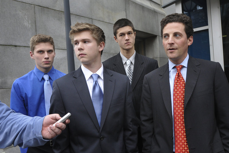 From left, Jackson Stevens, A.J. Asbury, Anthony Verville and attorney Paul Greene speak with the media after the three high school students lost their bid to play hockey on a Deering-Portland High co-op team.