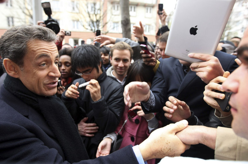 2011 Associated Press file A lower French credit rating could help determine whether President Nicolas Sarkozy, above, is re-elected next year.