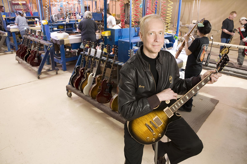 Henry Juszkiewicz, the chairman and CEO of Gibson Guitar Corp., spends time at the company's Nashville plant. Although authorities raided the plant and seized computers and Indian rosewood fret boards for guitars, the company has not been indicted or charged.