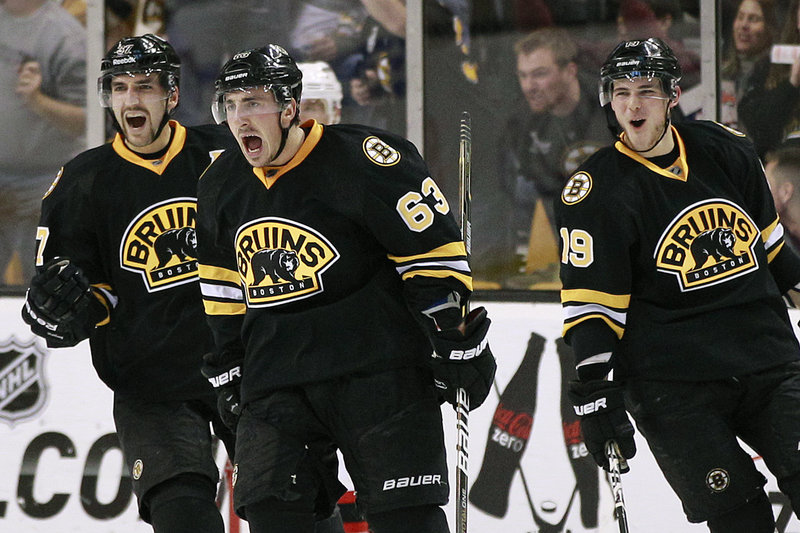 Brad Marchand has plenty to shout about after scoring against the New Jersey Devils Tuesday night in Boston. The Bruins scored late in the third period for a 4-3 win.