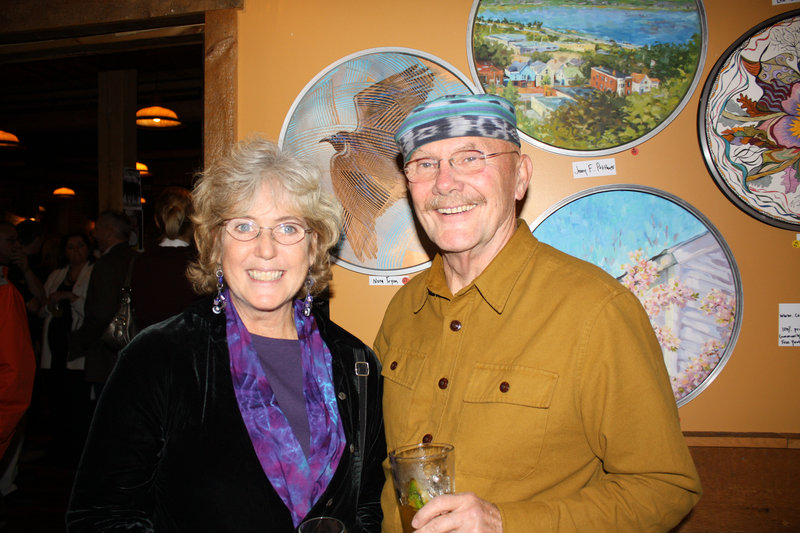 "Artist Nora Tryon and Richard Tryon, standing in front of the ""Taking Flight"" piece Nora Tryon created. The event was held at the Run of the Mill Pub & Brewery in Saco."