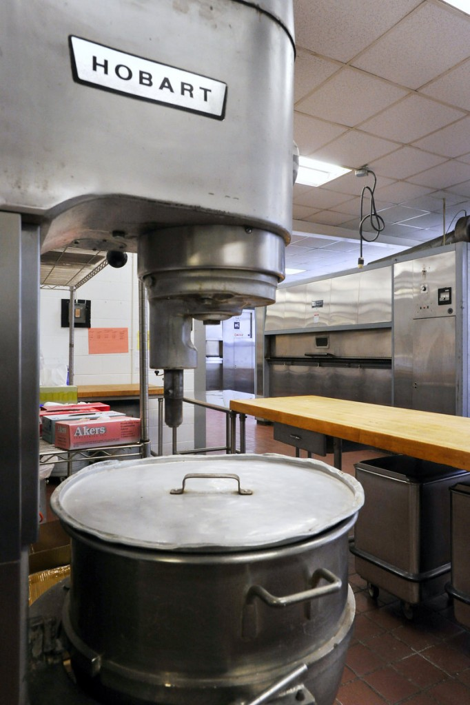 Three commercial mixers and ovens are in the cook's room at the central kitchen.