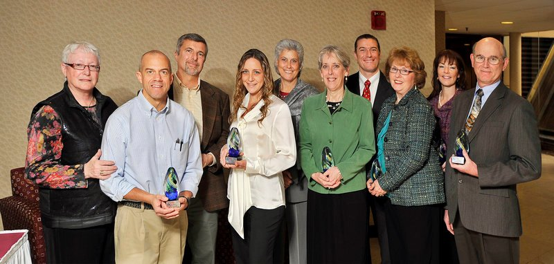 These community-nominated Health Care Heroes are honored at a luncheon at the Wyndham Airport Hotel in South Portland on Thursday. From left, they are: Jane Cleaves, a registered nurse at Maine Medical Center; Chris Sementelli, manager of sports medicine at Maine General Medical Center in Waterville; Dr. Ben Grasso, VA Maine Healthcare System psychiatrist; Sarah Harding, registered nurse at Maine General Medical Center; Marilyn Gugliucci, University of New England College of Osteopathic Medicine in Biddeford; Nancy Smith, Southern Maine Community College; Dr. Sean McCloy, Integrative Health Center of Maine in Portland; Linda McLaughlin, clinical nurse in the Neonatal Intensive Care Unit at Maine Medical Center; Catherine Lorello-Snow, program director of Spurwink's Portland Help Center; and Dr. Samual Broaddus, senior physician at Maine Medial Partners Urology in South Portland. Not pictured is honoree Dr. Michael Field, a Maine Medical Center physician.
