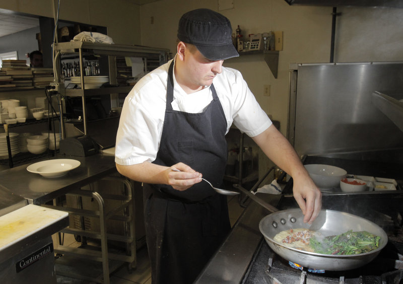 Chef David Ross of the restaurant 50 Local in Kennebunk prepares braised greens.