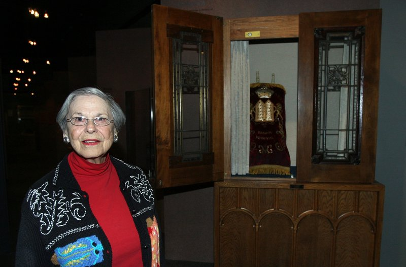 Miriam Freedman, a member of the Muskogee synagogue that closed, poses in front of an ark and Torah that were given to the Sherwin Miller Museum of Jewish Art along with other religious artifacts last month in Tulsa, Okla.